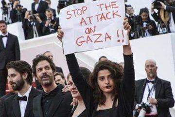 """فنانة لبنانية ترفع شعار """"اوقفوا العدوان على غزة"""" بمهرجان كان السينمائي"""